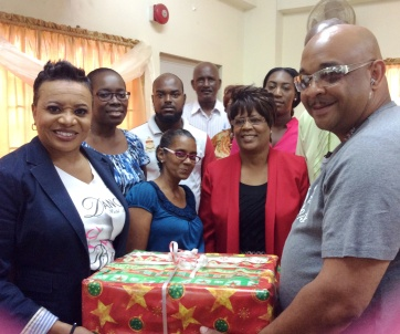 presenting a gift to the teachers of the Shekinah Christian Academy